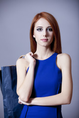 Redhead girl with bag