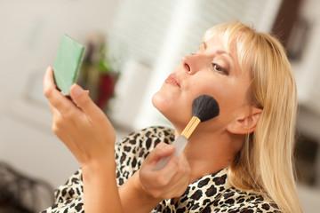 Blonde Woman Applying Makeup