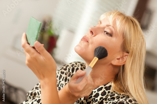 Blonde Woman Applying Makeup