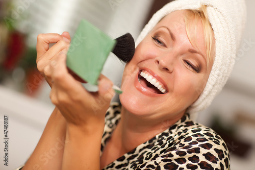 Blonde Woman Applying Her Makeup
