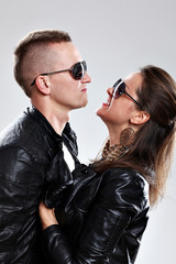 Young brutal couple in leather and sunglasses