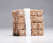 Square of brown and white sugar cubes stacked up