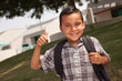 Happy Young Hispanic School Boy with Thumbs Up