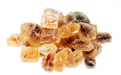 Heap of sweet sugar candies over a white background