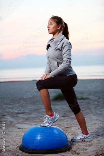 Young sporty girl doing workout outdoor