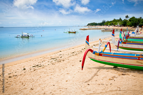 canvas print picture Traditional fishing boats on a beach in Nusa Dua on Bali.