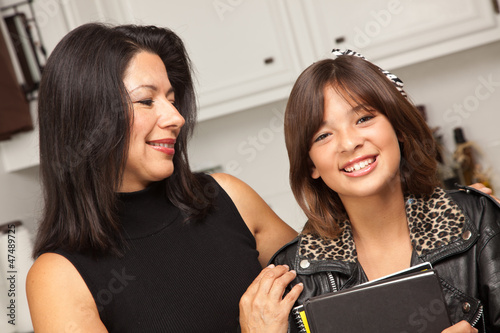 Pretty Hispanic Girl Ready for School with Mom