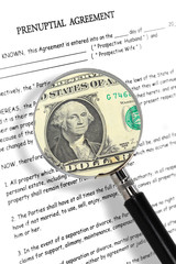 prenuptial agreement magnifying glass and dollar note