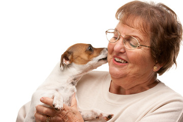 Happy Attractive Senior Woman with Puppy on White