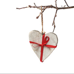 wooden heart hanging on branch of the tree