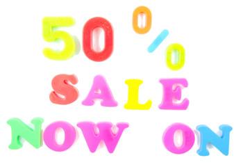 50% sale now on written in fridge magnets