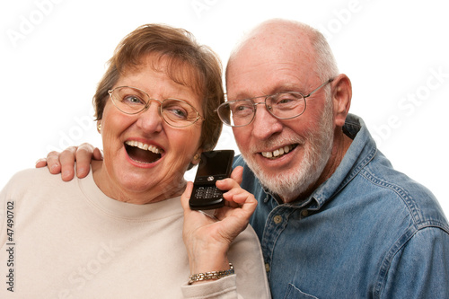 Happy Senior Couple Using Cell Phone on White