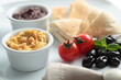 Meze with tomato, olives, and pita bread