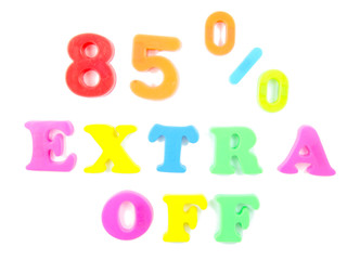 85% extra off written in fridge magnets