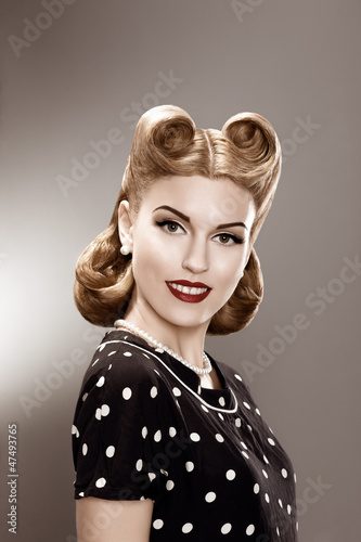 Vintage. Retro Woman in Polka Dot Dress Portrait - Pin Up
