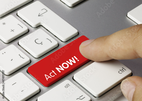 Act NOW! keyboard key. Finger