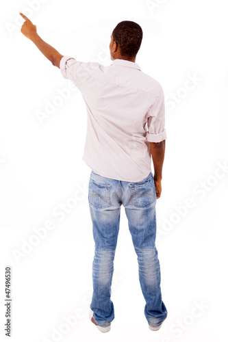 Young casual man pointing, isolated on white