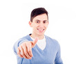 Young casual man thumbs up on white background