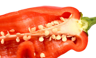 Fresh ripe appetizing sweet red dissected pepper on white