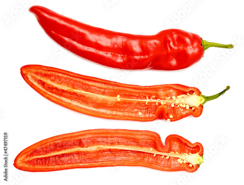Fresh ripe appetizing sweet red dissected pepper isolated