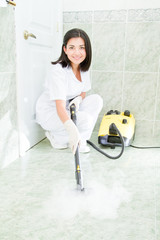 Young woman cleaning the bathroom