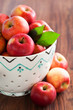 Fresh ripe apples in ceramic colander, selective focus