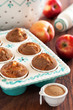 Apples and cinnamon muffins, selective focus