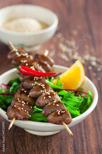 Grilled chicken hearts in spicy soy citrus marinade on skewers