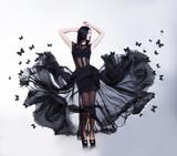 Fototapety Sensual Woman in Black Fluttering Dress with Butterflies. Swing.