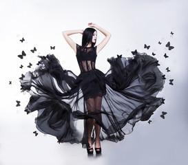 Sensual Woman in Black Fluttering Dress with Butterflies. Swing.