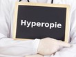 Doctor shows information on blackboard: hyperopia