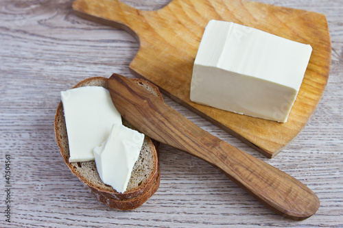 butter, wooden knife and bread