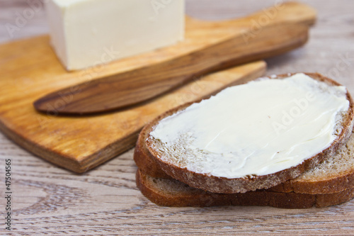 sandwich with butter knife and butter closeup