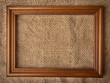 wooden frame on the background of burlap