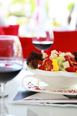 Mixed fresh salad with red wine