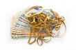 Leinwandbild Motiv Goldschmuck auf Euro Geldscheinen