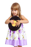 Attractive little girl holding vinyl record poster