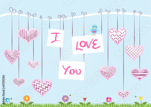 """I Love You"" hanging from a branch with decorated hearts"