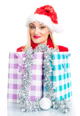 Cute christmas or santa claus woman with shopping bags