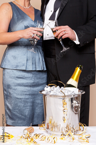 Couple touching glasses for a Champagne toast