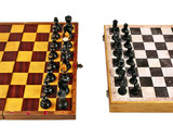 Two Old Chessboards with Figurines in Confilct