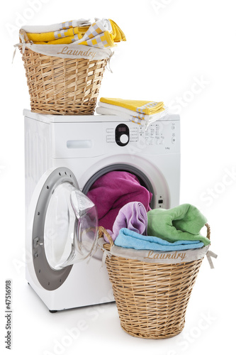 Laundry basket on a washing machine isolated on white background