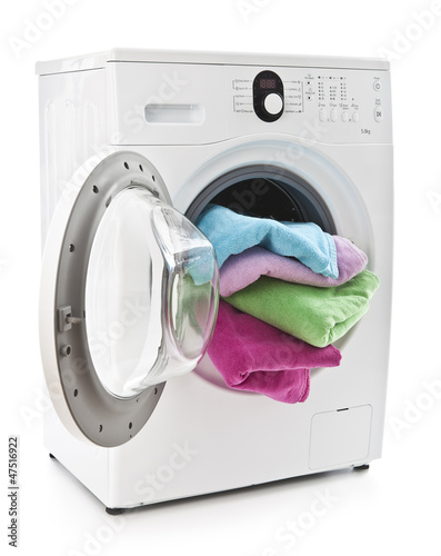Washing machine with laundry isolated on white