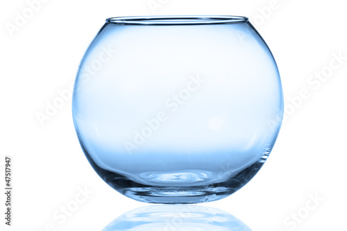 Empty fishbowl without water in front of white background.