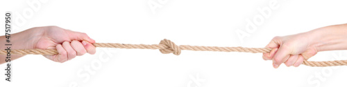 Hands pull rope isolated on white