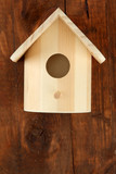 Nesting box on wooden background