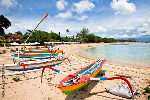 Foto op Plexiglas Indonesië Traditional fishing boats on a beach in Sanur on Bali