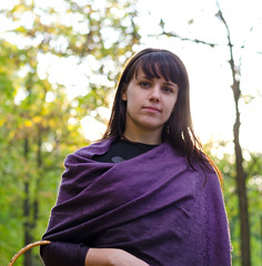 Young woman wearing a purple shawl