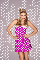 Retro fashion model in polka dot dress