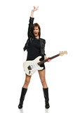 Fototapety Expressive woman screaming while playing the guitar
